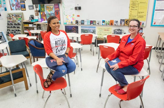 Algebra teacher Jamiliya McBride, left, and English teacher/yearbook director MaryJane Gardner pose in an empty Pine Forest High School classroom during the coronavirus shutdown in Pensacola on Tuesday, April 28, 2020.  Both teachers are eager to return to their classrooms when the schools reopen.