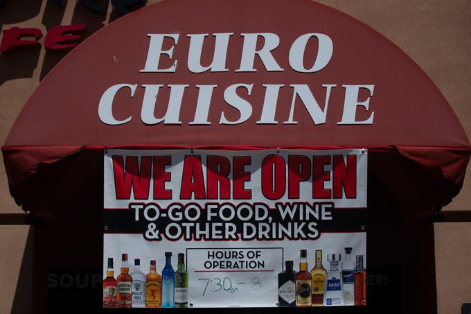 Euro Pizza Café is open for takeout food and alcohol orders in Fountain Hills on April 28, 2020. The cafe offers no dine-in service due to Arizona Gov. Doug Ducey's order as part of a statewide shutdown during the COVID-19 pandemic.