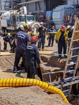 Glendale fire is assisting in rescuing a man stuck in a trench at SRP's Agua Fria Generating Station