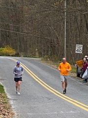 Bette Toews, left, of Lebanon got some help from brother-in-law Todd Dellinger while running her own personal Boston Marathon in Spring Hill Acres last Monday. Toews was set to run in Boston for the first time this year, but the COVID-19 pandemic forced the race to be postponed.