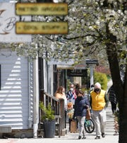 People go about their business along East Market Street in Rhinebeck on April 28, 2020.