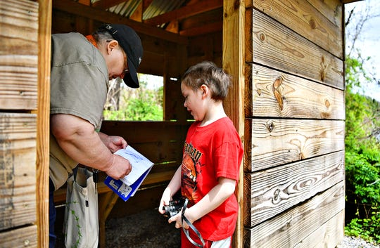 Wendy Looker, of Hanover, shows her grandson Aydan Looker, 6, notes that she took about birds that have been spotted in the area while exploring the bird blinds at Codorus State Park in Codorus Township, Saturday, April 25, 2020.  Dawn J. Sagert photo