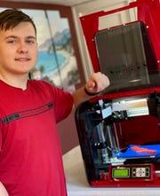 "Nick Rader, a freshman at Seton Catholic High School, produces ""ear savers"" with his 3-D printer."