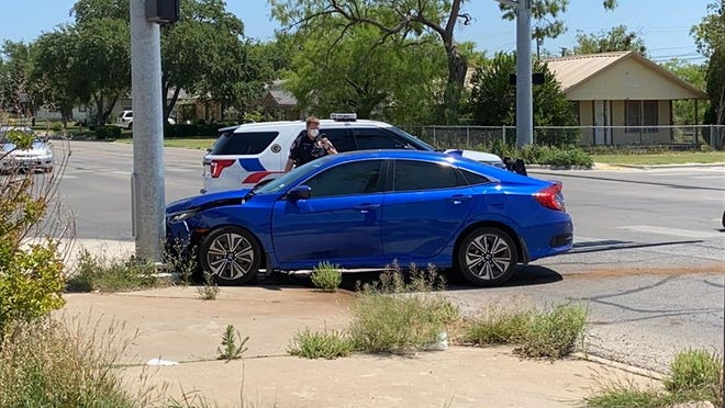 San Angelo police investigate a crash at the intersection of 19th Street and Martin Luther King Drive on Tuesday, April 28, 2020.