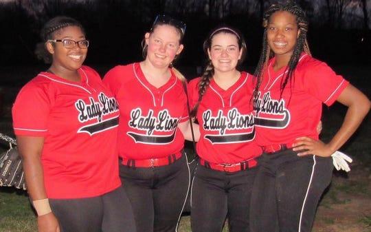 Plain Dealing senior softball players Lajerrica Ford, Jessica Lyles, Jenny Rae Langston and Shacorria Hogan celebrate.