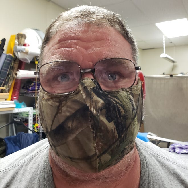 Mark DeGraw wears one of the face masks that Dell Rapids-based JR's Alterations and Crafts has made since the COVID-19 outbreak.