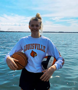 Washington junior Sydni Schetnan committed to play basketball and volleyball at the University of Louisville on Thursday.