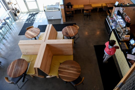 A customer places a to-go order on Tuesday, April 28, 2020 at Daily Clean Food and Drink in Sioux Falls, S.D. The restaurant offers curbside pickup and carryout to prevent the spread of the coronavirus.