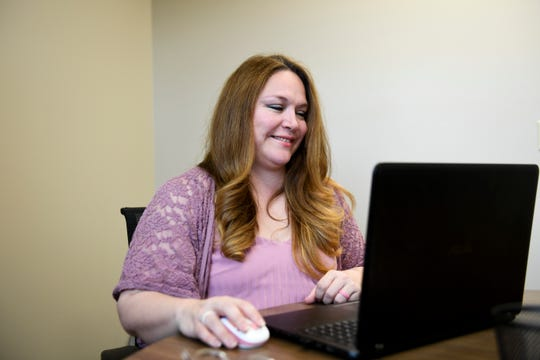 Nancy Reynoza works at her office on Tuesday, April 28, 2020 in Sioux Falls, S.D. Reynoza is the co-founder of Que Pasa Sioux Falls, a non-profit that works to provide resources to the Spanish speaking community.