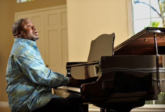 Gospel singer and producer Troy Sneed sings and plays the piano in the living room of his Orange Park home in January 2013. Sneed died of the coronavirus at age 52.