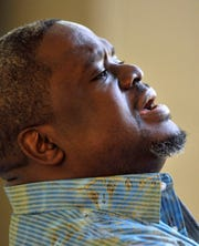 Gospel singer and producer Troy Sneed sings in the living room of his Orange Park home in January 2013.