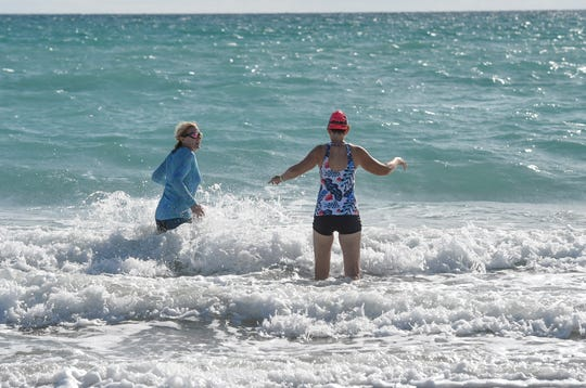 "Sisters Betty Jenkins (left) of Jensen Beach, and Eileen McConkie, a Port St. Lucie winter resident from Virginia, enjoy some time in the surf to go swimming at Waveland Beach on Tuesday, April 28, 2020, in southern St. Lucie County. ""It's awesome, it's great, I'm so happy it's open,"" Jenkins said. After more than a month the beaches in St. Lucie County are now open, with restrictions, to help prevent the spread of the COVID-19 virus."
