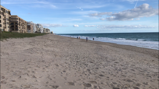 A smattering of swimmers, walkers and anglers dotted Waveland Beach April 28, 2020, the first day St. Lucie County beaches were open after closures in the wake of COVID-19 concerns.