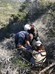A woman was rescued by helicopter Monday morning along a steep Thousand Oaks trail after a hiker heard calls help.