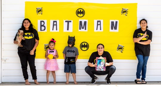 Families and neighbors waited patiently for Batman (Detective Art Cabello) and Tulare Police officers to pass theirs homes in Tulare on Monday, April 27, 2020.