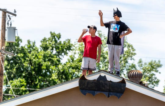 Many caught a glimpse of Batman (Detective Art Cabello) and Tulare Police officers cruising neighborhoods in Tulare on Monday, April 27, 2020.