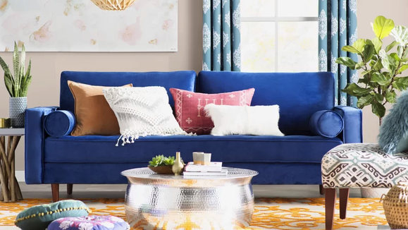 You'll want to sink into this velvet sofa for hours