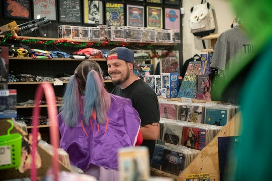 Morgan Albritton and Matt Layton share a moment as they work at her store, Morgan's Comics, on April 23, 2020. The two recently got engaged during a Facebook Live show they host at the store. ÒWith everything so unsure, I felt like one thing we could definitely be sure about is that weÕll be fine as long as weÕre together through all this,Ó he said.