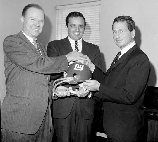 Wellington T. Mara, owner of the New York Giants of the NFL, and Giants head coach Allie Sherman, right, pose with Harland Svare when he was named Giants defensive coach, Feb. 15, 1967, in New York City.