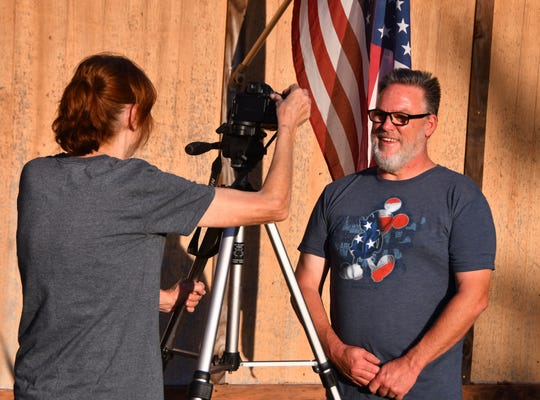 """David Brubaker's wife Dawn videotapes him singing. Every night since the safer-at-home order from Gov. DeSantis, he has sung """"God Bless America"""" from his porch at 7 p.m. to share hope for his community and country."""
