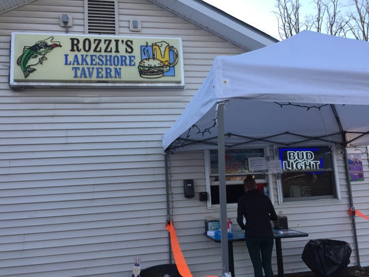 Rozzi's Lakeshore Tavern & Restaurant dispenses its takeout orders from a window off the Colchester eatery's parking lot.