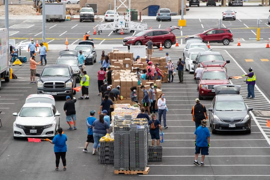 The Costal Bend Food Bank held a pop up food distribution in the La Palmera parking lot on Wednesday, April 29, 2020.