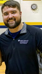 Jeremy Sipes, Mariemont high school athletic trainer poses.