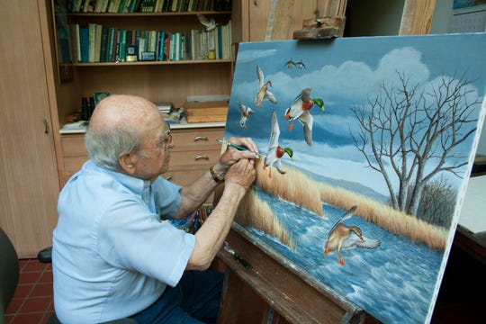 Noted artist Maynard Reece of Des Moines at work at the easel