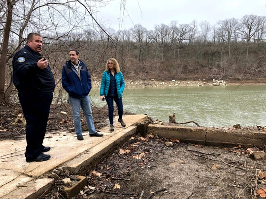 This photo taken March 10, 2020, in Arnold, Missouri, shows from left, Police Chief Robert Shockey, Colin Wellenkamp of the Mississippi River Cities and Towns Initiative; and Barbara Charry of The Nature Conservancy examining the ruins of an abandoned house along the Meramec River.