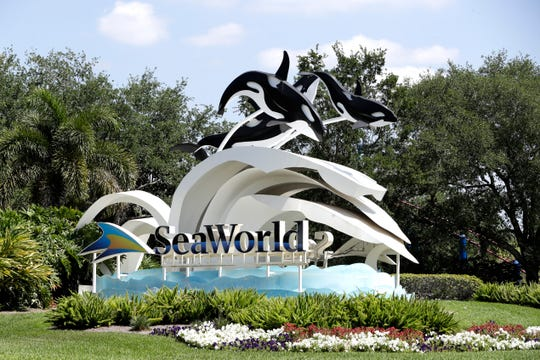 The entrance to the SeaWorld Theme park is seen Monday, March 30, 2020, in Orlando, Fla. SeaWorld is indefinitely furloughing more than 90% of its employees and they won't get paid after March 31.