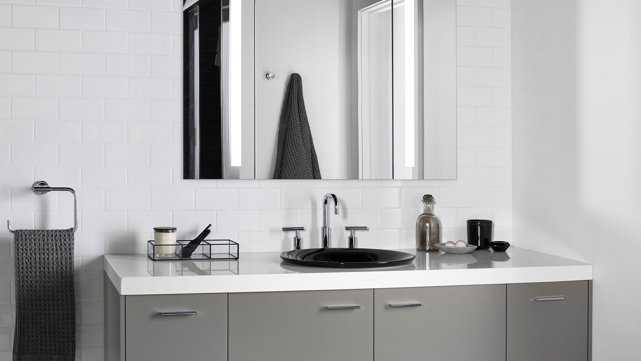 The Plumber Look Into A Modern Bathroom Mirror