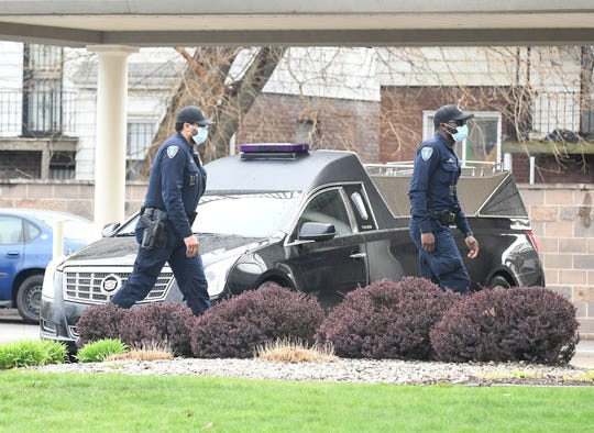 Detroit Police officers arrive during a public visitation for 5-year-old Skylar Herbert, from 9 a.m. to 9 p.m. April 29 at James H. Cole Funeral Home Northwest Chapel at 16100 Schaefer Highway in Detroit.