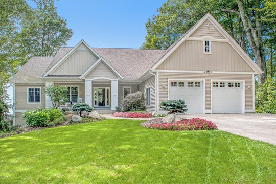 Located between Holland and Grand Haven, south of Pigeon Lake, this custom Cottage-Craftsman style home is great for entertaining and enjoying the Lakeshore.