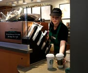 A Starbucks barista at the Warner Brothers Studio lot in Burbank, Calif., in this February, 2017, file photo.