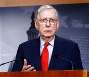 In this April 21, 2020, file photo Senate Majority Leader Mitch McConnell of Ky., speaks with reporters after the Senate approved a nearly $500 billion coronavirus aid bill on Capitol Hill in Washington.