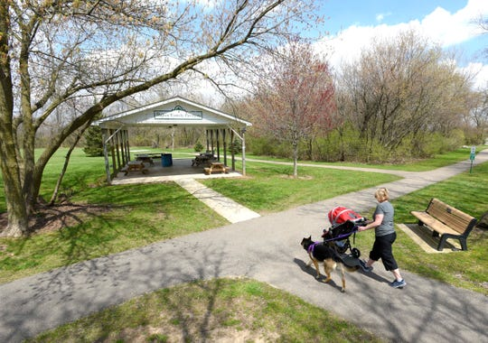 Bruce Township resident Dawn Currie pushes her two-year-old grandson, Wade Ray, in the stroller as they walk with her four-year-old female German Shepherd named, 'Sammie,' at the Bruce Township.