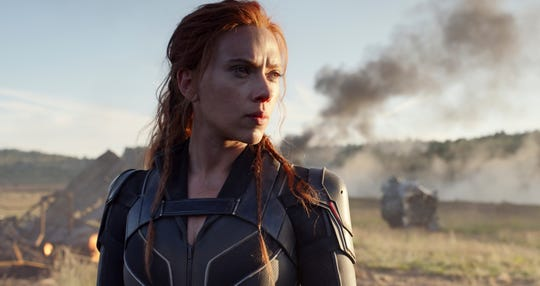 """Scarlett Johansson in a scene from """"Black Widow."""" The film was to kick off what promised to be a typically lucrative summer moviegoing season. It will now open Nov. 6."""