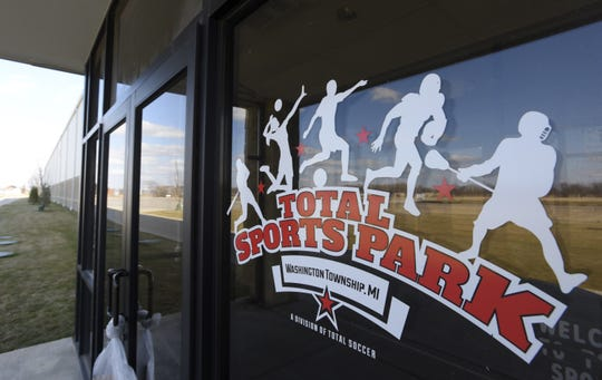 FILE - The Total Sports Park logo on the front door of the facility, located at 13555 Powell Rd. in Washington Township as seen on March 17, 2020.
