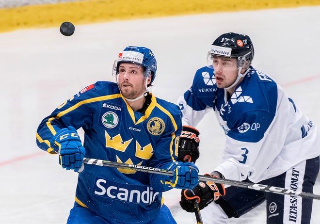 Sweden's Mathias Brome, left, battles Finland's Ville Pokka at Hovet Arena in Stockholm last year.