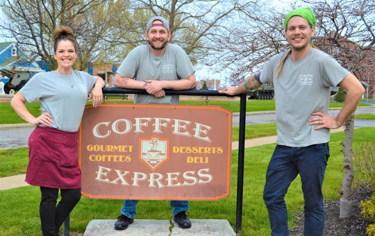 "Kylie Zunk, Curtis Kouts and Cory Preston Randall, from left, along with other staff members, have made and delivered hundreds of free meals to local essential workers as part of the ""Feed a First Responder Team from Coffee Express"" program. The program gives the shop and the community the opportunity to recognize and thank first responders, and it is also helping keep the shop open during the pandemic."