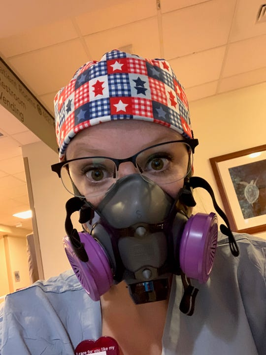 Woodmore grad Brittany Wolford with respirator.