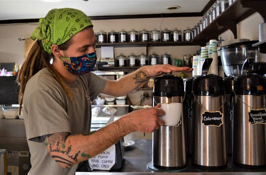 Cory Preston Randall pours a cup of coffee at Coffee Express on April 24. Randall and the other employees have prepared and delivered hundreds of free meals to local first responders.