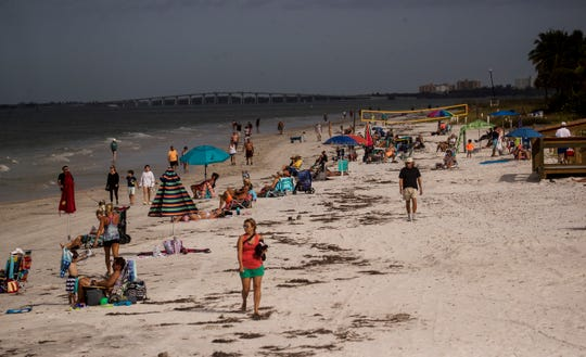 Beachgoers flock Lynn Hall Park on Fort Myers Beach in late April. Local beach vendors are expecting a busy Memorial Day weekend, although beach hours will be restricted in Naples and Collier County. FILE
