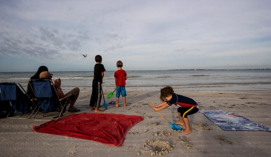 The Williams family from Fort Myers were some of the first people at Bowditch Point Park on the north end of Fort Myers Beach on Wednesday, April 29, 2020 morning. Lee County opened up the beaches it manages Wednesday to the public after they were closed because of the COVID-19 Pandemic. The beach that is managed by the town of Fort Myers Beach which is from Crescent Beach south is still only open to Fort Myers Beach residents from 7-10 a.m. for exercise.