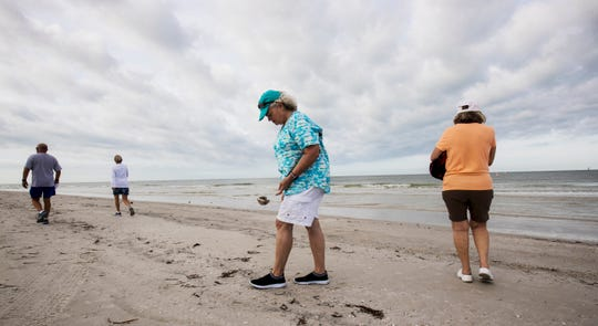 Rae Ann Burman, left, and Karen Robineau shell at Bowditch Point Park on the north end of Fort Myers Beach on Wednesday, April 29, 2020 morning. Lee County opened up the beaches it manages Wednesday to the public after they were closed because of the COVID-19 Pandemic. The beach that is managed by the town of Fort Myers Beach which is from Crescent Beach south is still only open to Fort Myers Beach residents from 7-10 a.m. for exercise. Burman is an ICU nurse at Gulf Coast Hospital.