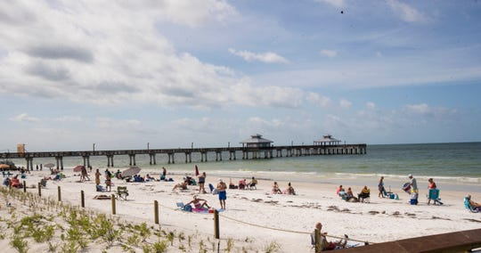 Beach goers are seen at Lynn Hall Park on Fort Myers Beach on Wednesday, April 29, 2020 morning. Lee County opened up the beaches it manages Wednesday to public after they were closed because of the COVID-19 Pandemic. The beach that is managed by the town of Fort Myers Beach which is from Crescent Beach south is still only open to Fort Myers Beach residents from 7-10 a.m. for exercise.