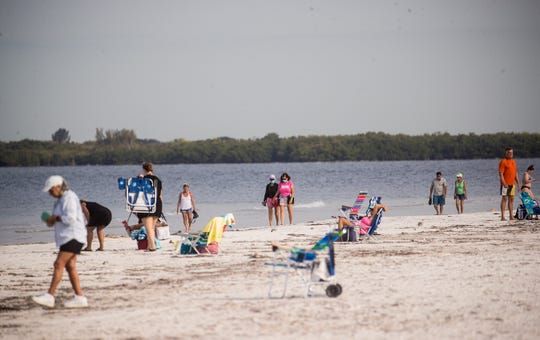 Beach goers are seen at Bowditch Point Park on the north end of Fort Myers Beach on Wednesday, April 29, 2020 morning. Lee County opened up the beaches it manages Wednesday to the public after they were closed because of the COVID-19 Pandemic. The beach that is managed by the town of Fort Myers Beach which is from Crescent Beach south is still only open to Fort Myers Beach residents from 7-10 a.m. for exercise.
