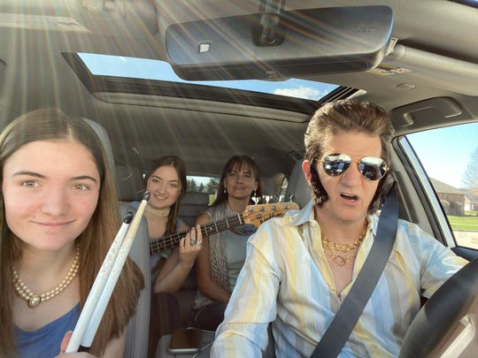 "The Schepp family, from left, Trista, Emma, Treena and Dave, crank up Elvis Presley's ""Fever"" for their coronavirus-themed take on ""Carpool Karaoke"" in De Pere."