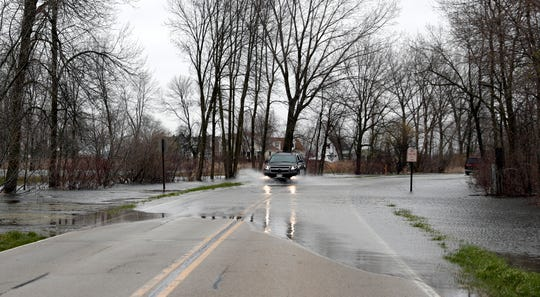 Strong winds on the bay cause flooding on Sunset Beach Road on April 29, 2020, in Suamico, Wis.