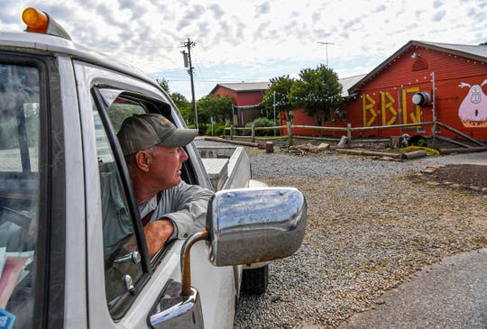 Sam Shirley of Fair Play drives by Smokin' Pig BBQ in LaFrance Wednesday, April 29, 2020. Smokin' Pig is one of several iconic eateries area local residents and Clemson University eat at and have adjusted to the COVID-19 pandemic with take-out only from their full menu on their regular days and hours, Thursday, Friday, and Saturday 11 a.m. to 8 p.m.